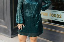 a dark gree shiny holiday dress with long sleeves and matching dark green shoes are all you need to make a statement