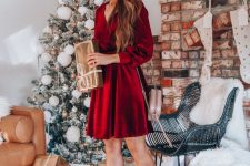 a deep red velvet wrap dress and fancy shoes are all you need to pull off a stylish and chic look at Christmas