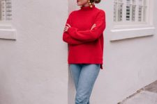 a girlish holiday look with a red sweater, light blue jeans, pink buckle shoes and statement earrings