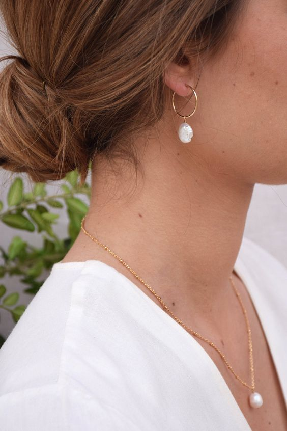 a gold hoop earring with a baroque pearl is a lovely idea to go for, it's very girlish and very trendy