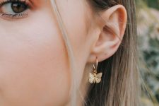 a gold hoop earring with a butterfly is a very feminine and girlish solution for your looks