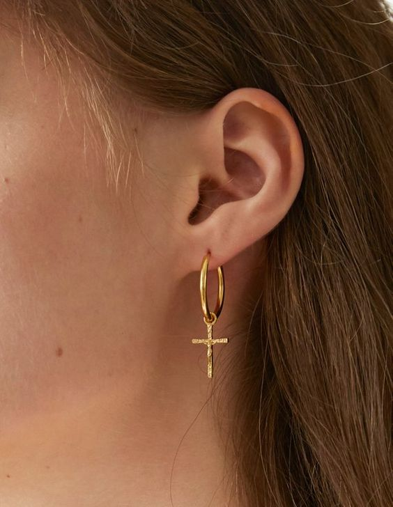 a gold hoop earring with a cross is a timeless idea that always works and that will be always actual