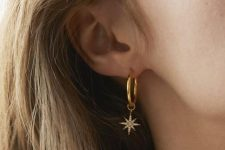 a gold hoop earring with a large embellished star is an ultimate idea to go for and it looks amazing