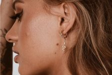 a gold hoop earring with a snake is a very original and catchy idea to spruce up your look