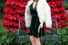 a green velvet wrap mini dress, a white fuzzy jacket, metallic shoes and a bag for a glam Christmas party