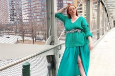 a jaw-dropping outfit with an emerald sweater, a turquoise midi skirt, black boots and a catchy turquoise bag