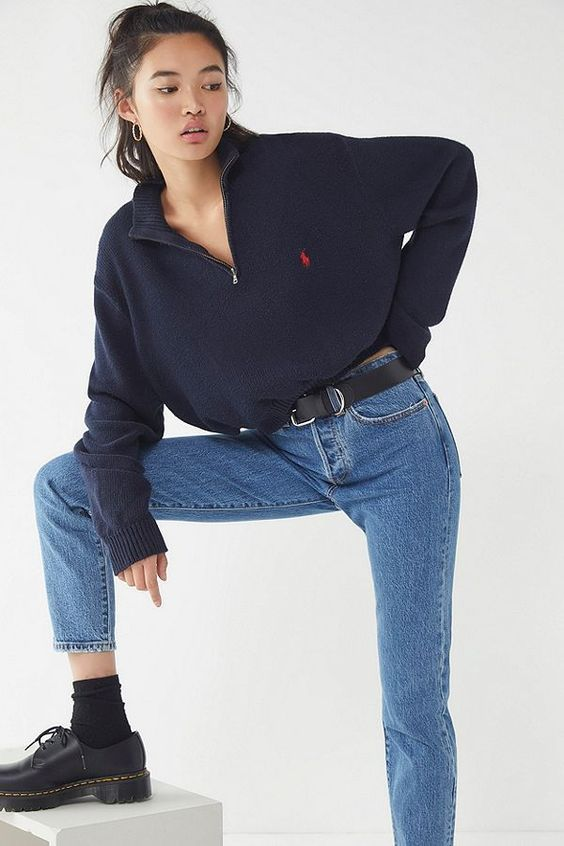 a navy zip sweater , blue jeans, black shoes and socks for a comfortable and trendy look