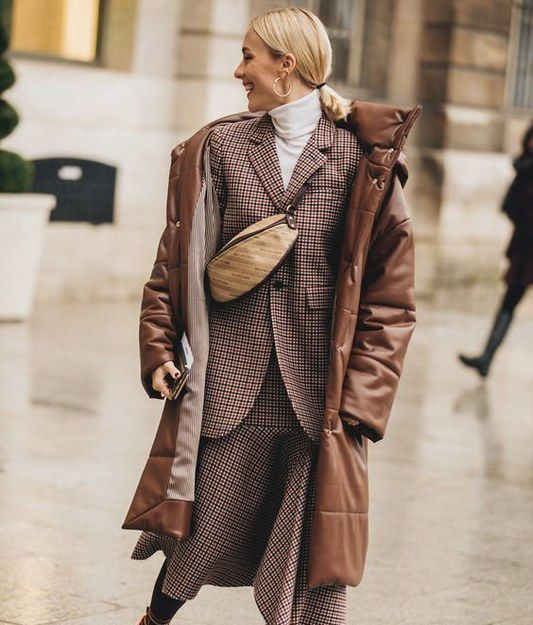 a plaid skirt suit, a white turtleneck, a waistbag, a brown leather puffer coat for a winter work look