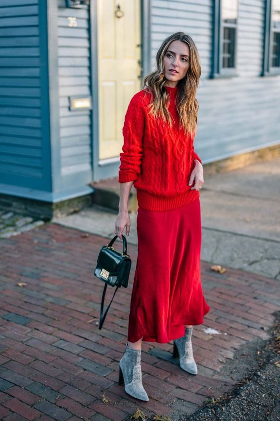 a red braided sweater, a deep red midi skirt, grey booties and a small black bag for a super chic winter look
