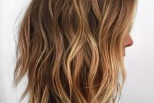 a shaggy long bob haircut with warm blonde blayage and waves looks beautiful and very natural