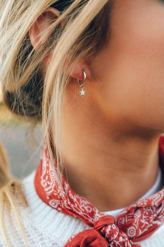 a silver hoop earring with a silver star is a lovely accessory that will match most of outfits you rock
