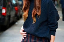 a simple and sexy look with a tweed mini skirt, a teal sweater and gold watch is a fantastic idea
