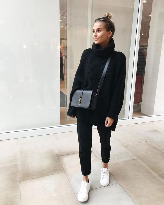 a simple look with a black oversized sweater, black jeans, white sneakers, a black crossbody bag