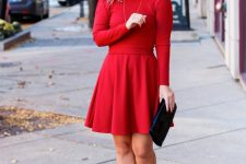 a simple yet cute red A-line dress with long sleeves, a black clutch and shoes will be a nice outfit for a holidya party