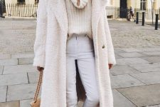 a stylish all-natural look with an oversized sweater, white jeans, two tone heels and a tan bag plus a white faux fur coat