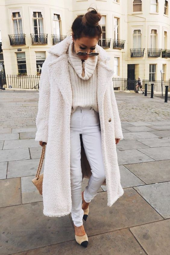 a stylish all natural look with an oversized sweater, white jeans, two tone heels and a tan bag plus a white faux fur coat