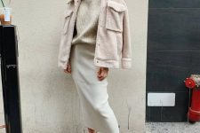 a stylish look with a neutral turtleneck sweater, a creamy pencil midi skirt, white booties and a neutral faux fur jacket