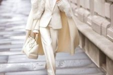 a super elegant white outfit with a pantsuit, a turtleneck, boots, a midi coat with faux fur and a bag