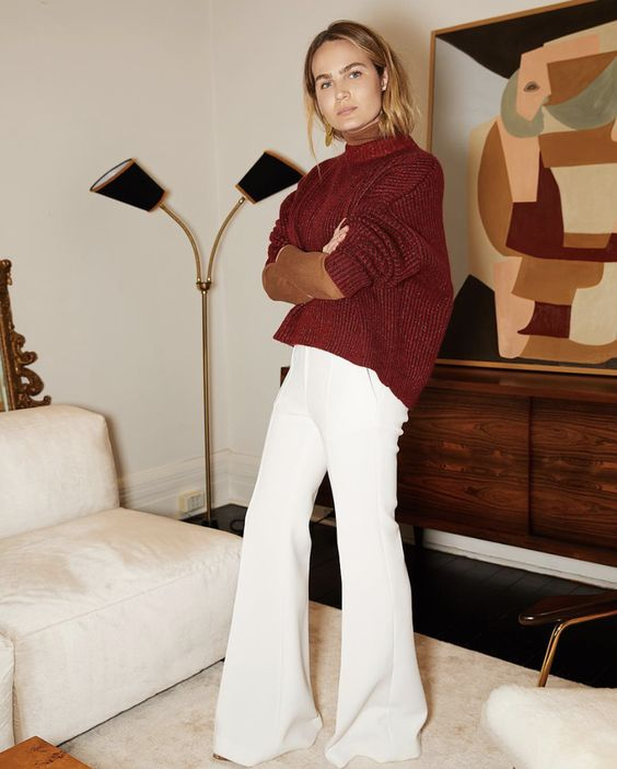 a tan turtleneck, an oversized burgundy sweater, white palazzo pants for a colorful and comfy look