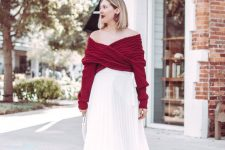 a timeless girlish look with a burgundy wrap off the shoulder sweater, a white pleated midi skirt, silver shoes and a statement earrings