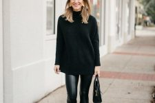 a total black look with leather leggings, an oversized turtleneck sweater, suede booties and a bag is chic