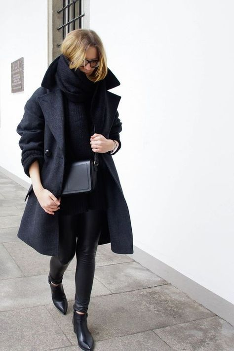 a total black look with leather leggings, boots, a sweater, a coat and a scarf plus a crobbody bag