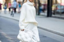 a trendy outfit with an oversized sweater, wideleg pants, shoes and a puff bag is super chic and bold