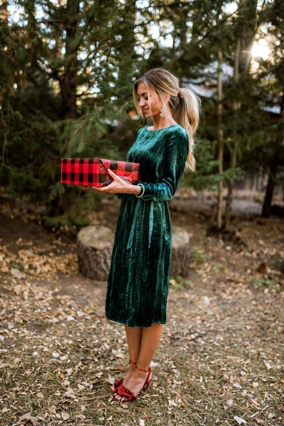 a velvet emerald fitting midi dress with a high neckline and long sleeves plus red ruffle shoes look cute