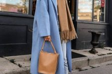 a warm beige scarf echoing the boots and the bag, blue jeans and a blue coat for a chic winter look