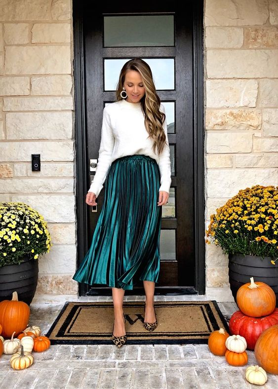 a white jumper, a metallic hunter green pleated midi, leopard shoes and statement earrings for Christmas