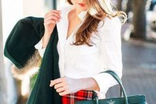 a white shirt, a red plad mini, a green bag and a green coat for a stylish and sexy Christmas outfit