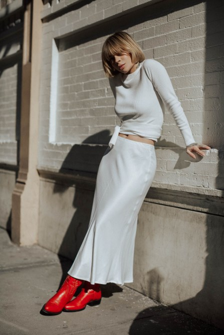 a white sweater, a white slip maxi skirt and red boots for a sexy and impressive winter look