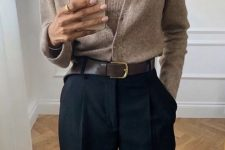 a work outfit with black pants, a beige knit top and a matching cardigan plus a brown belt is very stylish