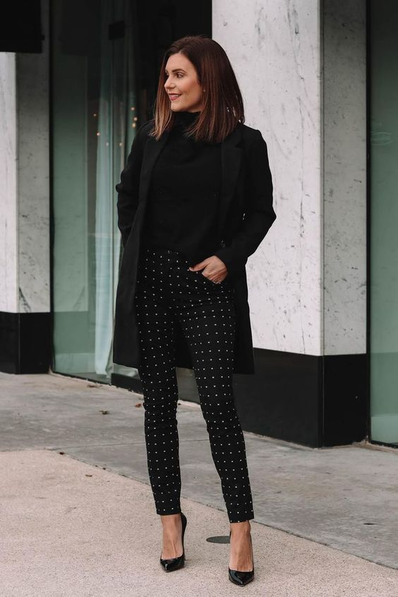 an elegant total black look with a turtleneck, a short coat, printed pants and heels is extremely chic
