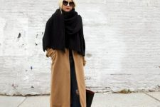 an oversized and warm black scarf covering the upper part of the body will keep you very warm and cozy