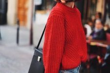 an oversized red chunky knit sweater, blue jeans, a red hat, a black bag and red lips