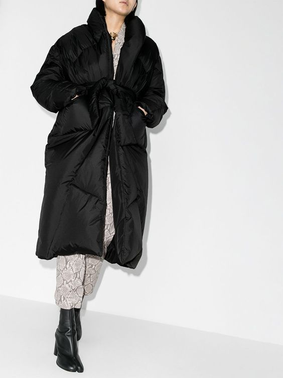 black booties, snakeskin print pants, a black puffer coat with a belt for a trendy winter look