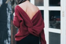 black jeans, a burgundy sweater with a knotted cutout back and some black booties for a statement