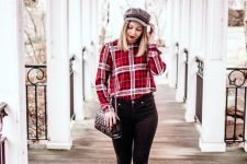 black skinnies, red boots, a red plaid shirt, a black bag and a grey cap for an everyday Christmas look