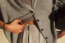 grey pants, a grey knit top and a matching cardigan plus a black bag for a comfortable everyday look