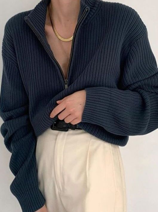 ivory pants, a black belt and a graphite grey zip sweater plus a statement necklace for a cool look