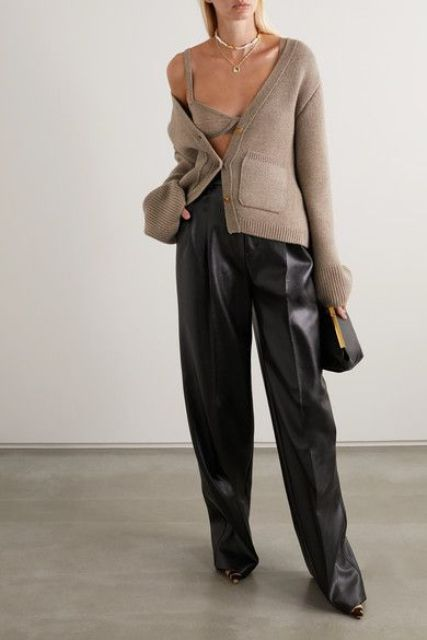 leather pants, a grey knit crop top, a matching cardigan, a black clutch for a super bold and trendy look