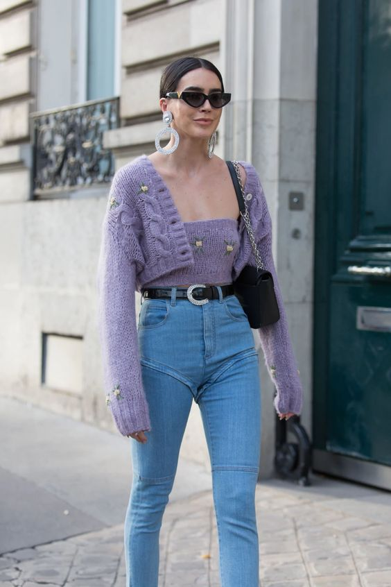 light blue jeans, a purple knit top and a matching cardigan, statement earrings and a black bag for a cute girlish look