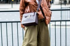 olive green wideleg pants, brown boots, a brown leather puffer jacket and a burgundy bag for fall or winter