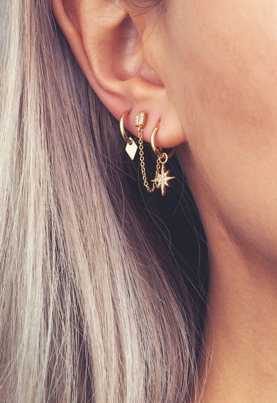small gold hoop earrings with star and geometric pendants and a stud with a chain look wow