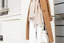 white pants, tan shoes, a blush oversized scarf, a tan coat and a neutral bag for an ethereal winter look
