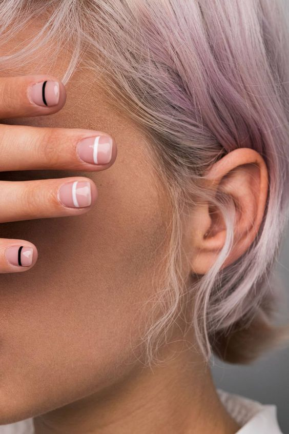 nude nails with black and white horizontal stripes are a cool and simple minimalist nail art idea