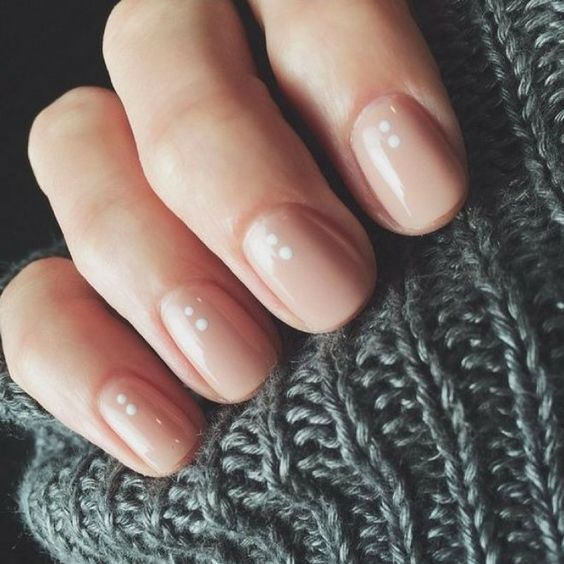 nude nails with little white dots are another great idea that will match many outfits if not all of them
