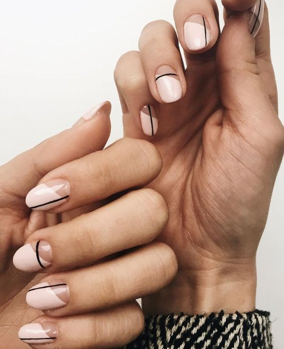 07 a modern nude and white color block manicure with black stripes for a contrast and eye-catchiness