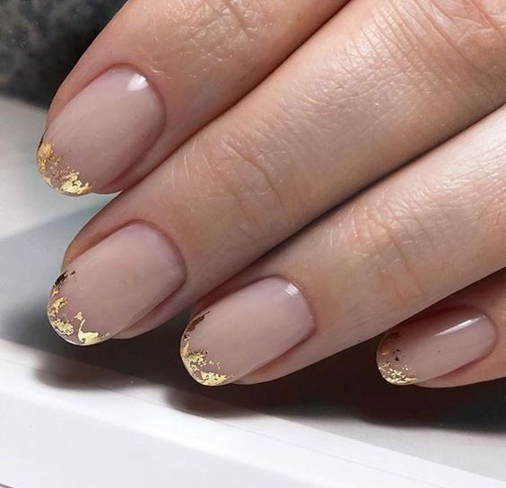 11 a French manicure done with gold foil on the edge is a fresh way to wear these classic nails
